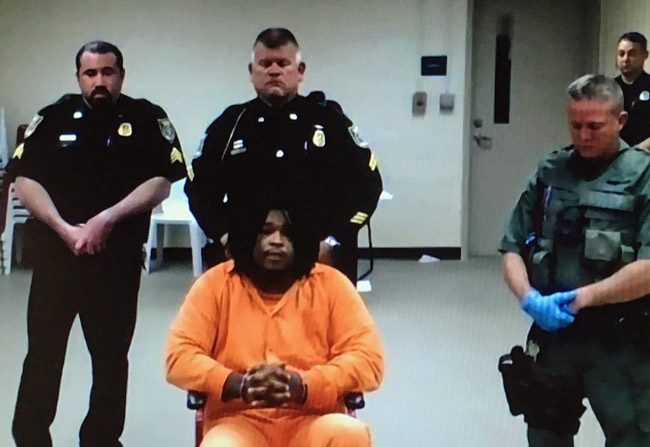 Phillip Haire Jr., who faces multiple attempted murder charges, appears in court today in a pre-trial hearing. (c FlaglerLive via court feed)