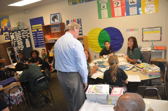 Phoenix Academy at its zenith, in May 2012, when it was showcased for then-Sen. John Thrasher, seen here speaking with students in Sue Noble's classroom. Phoenix will close and 'transition' to Wadsworth Elementary's STEM Academy. (© FlaglerLive)