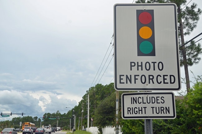 That right-turn part, seen here at a sign on Belle Terre in Palm Coast, may soon be declared unenforceable by the Florida Legislature. (© FlaglerLive)