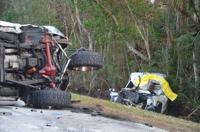 The front of the Ford pick-up truck, on its side, with the car it struck as it ended up in the ditch on Old Dixie Highway. Click on the image for larger view. (c FlaglerLive)