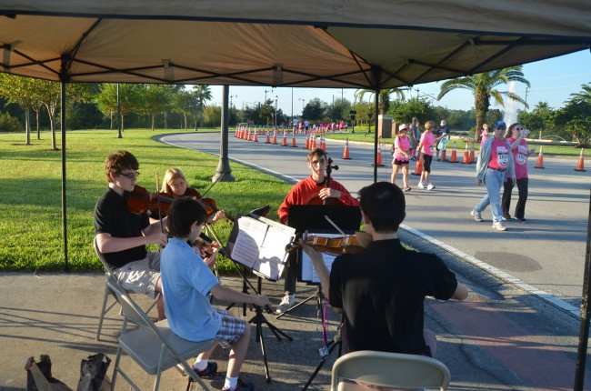A quintet of the Flagler Youth Orchestra kept the runners strung up. Click on the image for larger view. (© FlaglerLive)