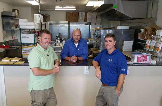 The ceaseless restaurateurs: from left, Chris Zwirn, Joe Rizzo, and new partner Trevor Tucker, whose building on County Road 305 is home to Pit Stop Pizza.