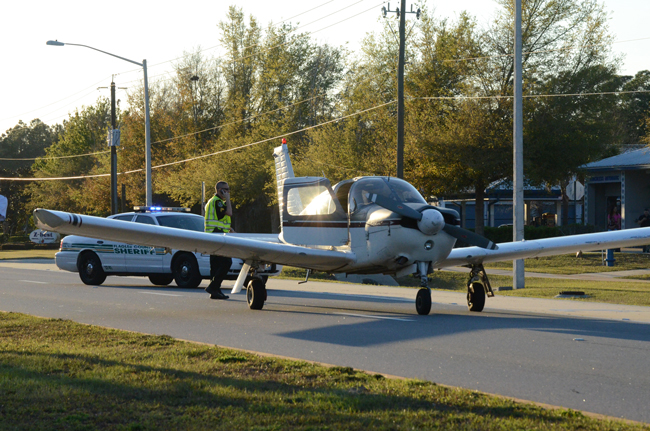 No one was hurt. The plane sits on Palm Coast Parkway West. (c FlaglerLive)