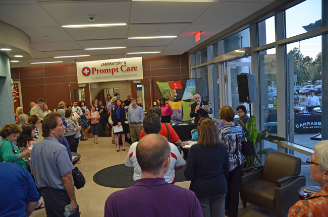 Florida Hospital Flagler's open house for its new Prompt Care initiative with the school district drew quite a crowd Tuesday evening. Ken Mattison, the hospital's CEO, is speaking to the right. (© FlaglerLive)