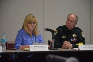 The Sheriff's Office's Becky Quintieri, briefing the panel on conditions at the jail, and Sheriff Rick Staly this morning. (© FlaglerLive)