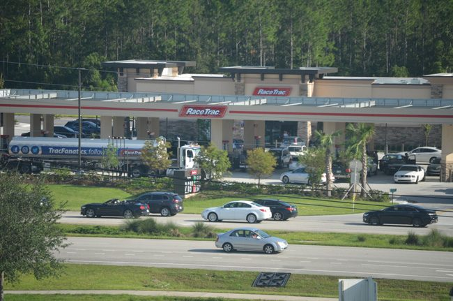 The mega Race Trac gas station at State Road 100 and Seminole Woods Boulevard near I-95, late Tuesday afternoon, with a fuel truck emptying its cargo, was busy fueling up cars, many of them heading home to South Florida. (c FlaglerLive)
