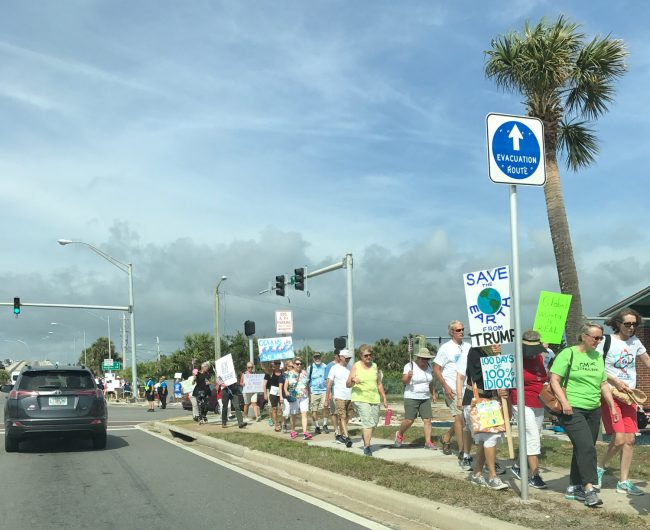 On the way to the rally. Click on the image for larger view. (© Contributed for FlaglerLive)