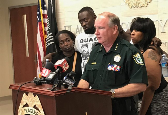 Sheriff Rick Staly was flanked by members of Ahmad Rashad Laster's family this afternoon as he announced the arrest of Laster's alleged murderer. (© FlaglerLive)