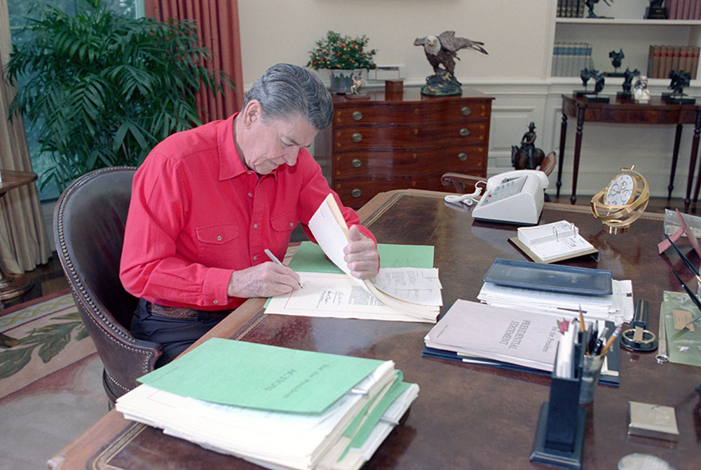 President Reagan signing the Fiscal Year 1989 Appropriations Bills at his desk in the Oval Office in October 1988. (White House)