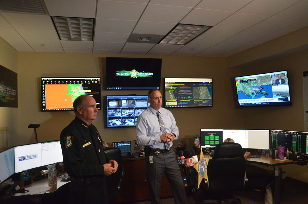 Sheriff Rick Staly and Chief Paul Bovino explaining the Real-Time Crime Center, operating since spring, and shown to reporters today. (© FlaglerLive)