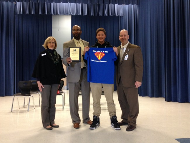 Tyler Irogoyen today after his recognition, with, from left, School Board member Janet McDonald, Buddy Taylor Principal Stephen Hinson, and Superintendent Jacob Oliva. Click on the image for larger view.