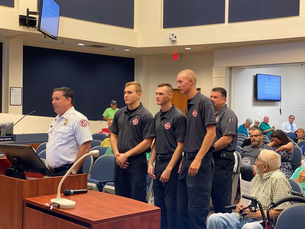 Noah Dunaway, Dylan Cronk and Beau Kruithoff, with Chief Don petito on one side and Deputy Chief Joe King behind them, as they appeared before the County Commission this morning, in a picture taken by Commissioner Joe Mullins.