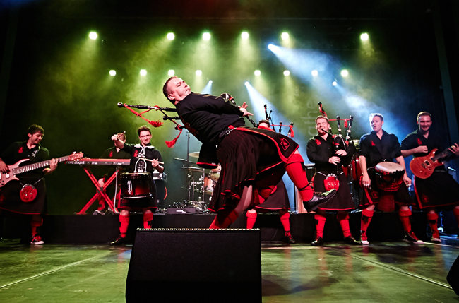 The Red Hot Chilli Pipers bring their act to the Flagler Auditorium Tuesday evening.