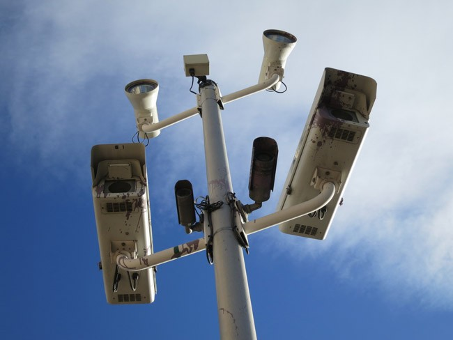 Time after time in court, the legality of red-light camera programs like Palm Coast's has been spattered and battered . (Paul Sableman)