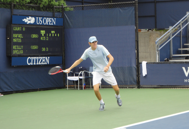 Reilly Opelka, playing in the main draw of the Juniors U.S. Open championship Tuesday, is ranked 10th in the national 16 and under division. (© Michael Lewis for  FlaglerLive)