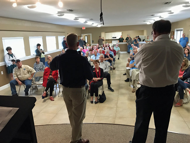 A sizable crowd turned out on short notice for a town hall meeting on beach repairs and short-term vacation rental issues affecting the Hammoc Saturday afternoon at the Hammock Community Center. The town hall meeting was hosted by Rep. Paul Renner, left, and County Commissioner Greg Hansen. (© FlaglerLive)