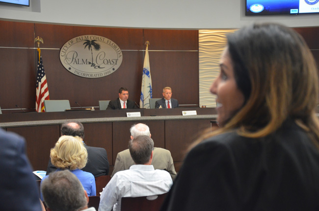 Sen. Travis Hutson, left, and Rep. Paul Renner, at October's local legislative delegation meeting. Palm Coast Mayor Milissa Holland, in the foreground, has voiced opposition, along with the city council, to a proposal by Paul Renner to expand the role of surgery recovery centers. (c FlaglerLive)