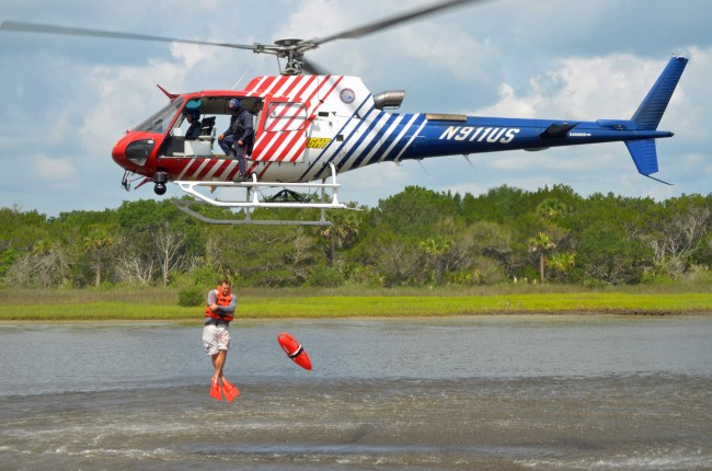 Ten members of Flagler County Fire Rescue and five Flagkler County Sheriff's deputies jumped out of Fire Flight up to five times each today in  a rescue training operation over the Intracoastal that will vastly enhance water-rescue capabilities in the county. Click on the image for larger view. (© FlaglerLive)