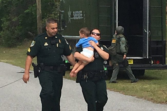 An image the sheriff's office released this afternoon of the rescue of the 2-year-old boy, who was not harmed, in the course of a domestic violence issue involving his parents on Parkview Drive this afternoon. (FCSO)