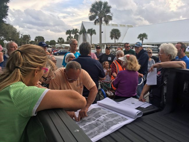 """The """"tailgate"""" meeting had been suggested by Commissioner Marshall Shupe last year, mirroring similar roadside meetings at previous swale-digging sites. (© FlaglerLive)"""
