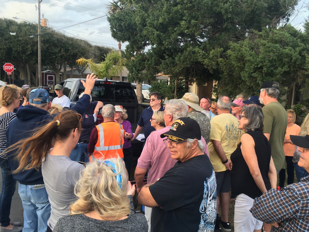 Unhappy Flagler Beach residents gathered at the corner of South Daytona Avenue and South 15th Street Thursday evening to hear a city official explain the project digging swales at the south end of town. It did not go as planned. (© FlaglerLive)