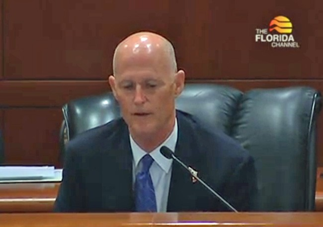 Rick Scott at a cabinet meeting earlier this month, in a still from a Florida Channel broadcast.