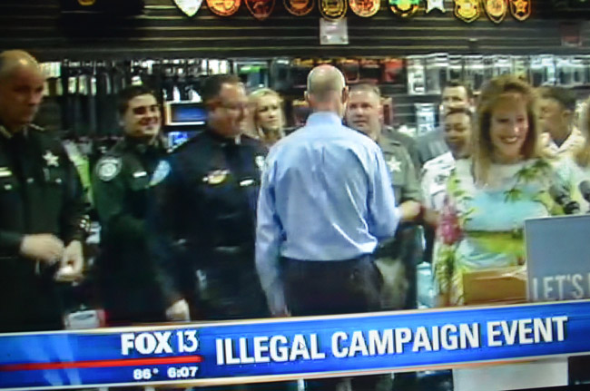 A screen shot of Tampa's Fox station report on the Scott campaign event in question.