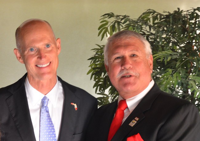 They'll get to do it again next week: Gov. Rick Scott with Frank Meeker, now the chairman of the Flagler County Commission, at a local Republican dinner two years ago. (© FlaglerLive)