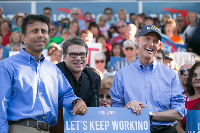 The three governors: Bobby Jindal,  Rick Perry and Rick Scott on Monday evening. (Facebook)