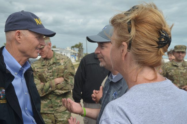Flagler Superintendent Jacob Oliva, center, speaking with Gov. Rick Scott, with School Board member Colleen Conklin, last October in Flagler Beach. The school board is asking the governor to veto a massive education bill the Flagler district, like many across the state considers damaging to the system. (© FlaglerLive)