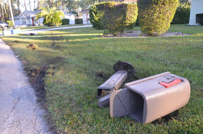 Joseph Faircloth crashed into the mailbox at 87 Rickenbacker Drive and ended up in the next driveway at 85 Rickenbacker. (© FlaglerLive)