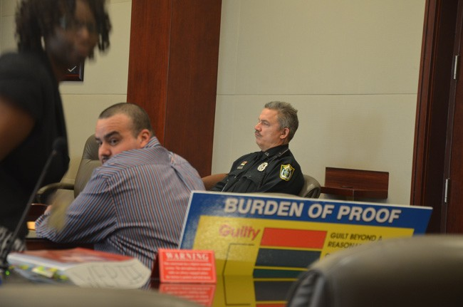 Waldemar Rivera, accused of raping his step-daughter, just before closing arguments this morning in Flagler County Circuit Court.  His lawyer, Regina Nunnally, is to the left. (c FlaglerLive)