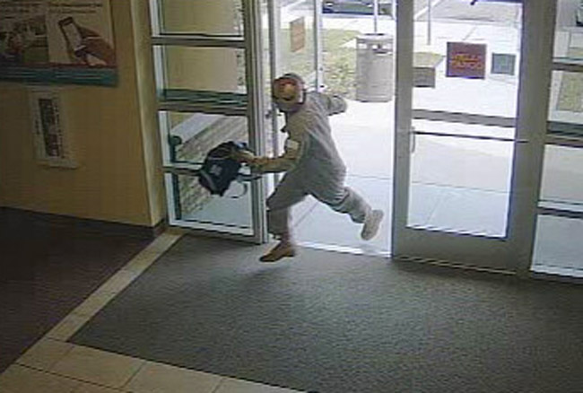 The robber entering the bank.