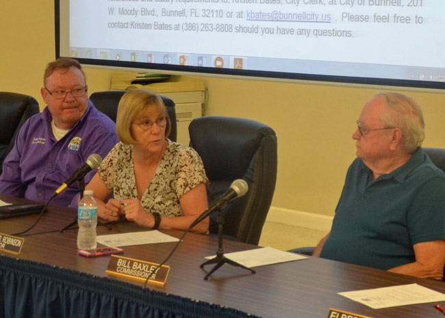 Bunnell city commissioners are unhappy with the county. From left, John Ropgers, Mayor Catherine Robinson, and Bill Baxley. Not pictured were Donnie Nobles and Jan Reeger, who also voted for a resolution condemning the county's decision to locate a sheriff's building in Palm Coast. (© FlaglerLive)