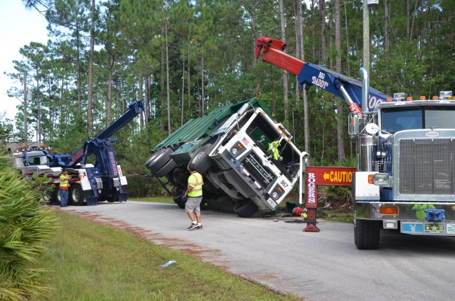 Roger's Towing took care of the operation. Click on the image for larger view. (© FlaglerLive)