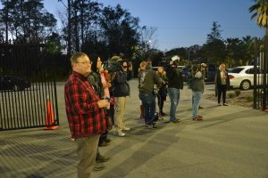 Ron with other media in January outside the Sheriff's Office's Operations Center, awaiting the exit of a murder suspect. (© FlaglerLive)