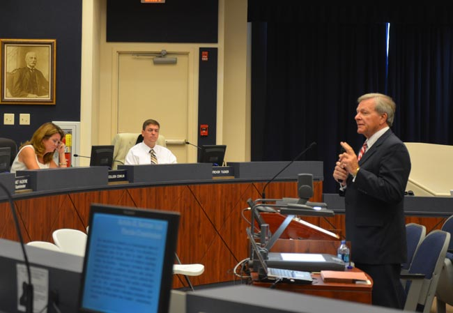 Ronald Meyer, right, an attorney, has been challenging imbalances in the state's educational system for years. He was invited to address the board by Colleen Conklin, left. Trevor Tucker is at center. (FlaglerLive)