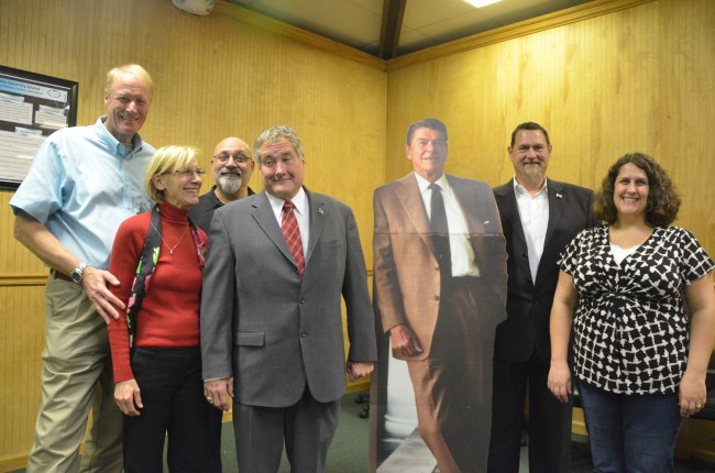 The candidates, flanking a cardboard cut-out of Ronald Reagan. From left, with their race in parenthesis: Dennis McDonald (County Commission), Janet McDonald (Schoolo Board), Steve Nobile (Palm Coast City Council), Michael McElroy (School Board), Mark Richter (County Commission) and Anne-Marie Shaffer (Palm Coast City Council). Click on the image for larger view. (© FlaglerLive)
