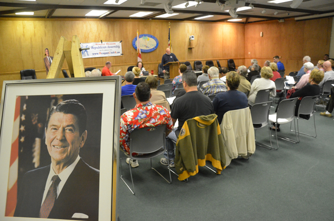 In the glow of Ronald Reagan: Monday's meeting of the Ronald Reagan Republican Assemblies at the Palm Coast City Council introduced six of seven candidates running against local incumbents. (© FlaglerLive)