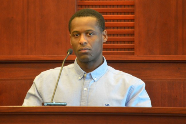 Roodlyn Mompremier on the stand in his own defense on Tuesday. (c FlaglerLive)