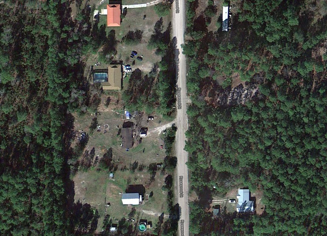 The property is toward the center of the picture.