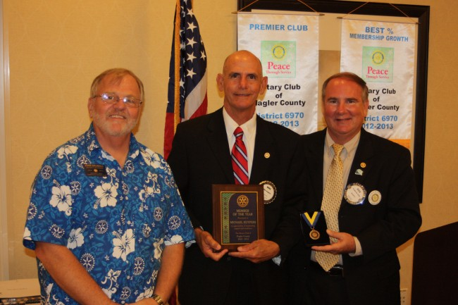 Rotarian Mike Kuypers, center, received the Rotarian of the Year Award from District Governor John Brunner and President Staly. Click on the image for larger view. (Rotary Club)