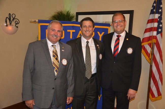 Three presidents: From left, President-Elect Tracy Loftus, President Jim Troiano, and Past-President Matthew Maxwell. (© FlaglerLive)