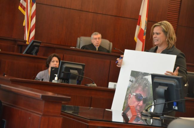 Then-Assistant State Attorney Jackie Roys held up an image of Dana Mulhall to the jury during Paul Miller's trial in 2013. Click on the image for larger view. (© FlaglerLive)