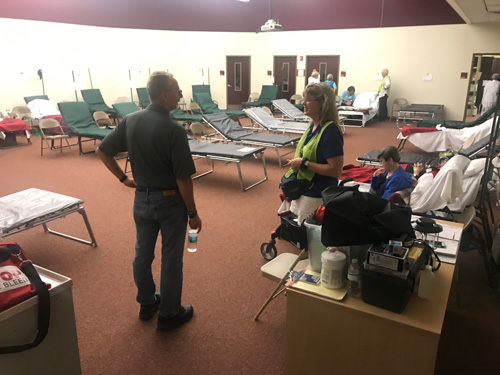Superintendent Jim Tager with a care worker at Rymfire Elementary, the special needs shelter, which by this evening had 93 clients and 47 caregivers. (Jason Wheeler, Flagler Schools)
