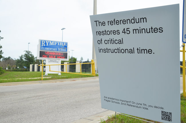 Campaign signs supportive of the referendum have gone up on school grounds, as at Rymfire Elementary in Palm Coast. (© FlaglerLive)