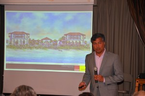 Salamander President Prem Devadas at the Hammock Conservation Coalition meeting Tuesday, with a rendition of the proposed development, as seen from beach level. Click on the image for larger view. (© FlaglerLive)