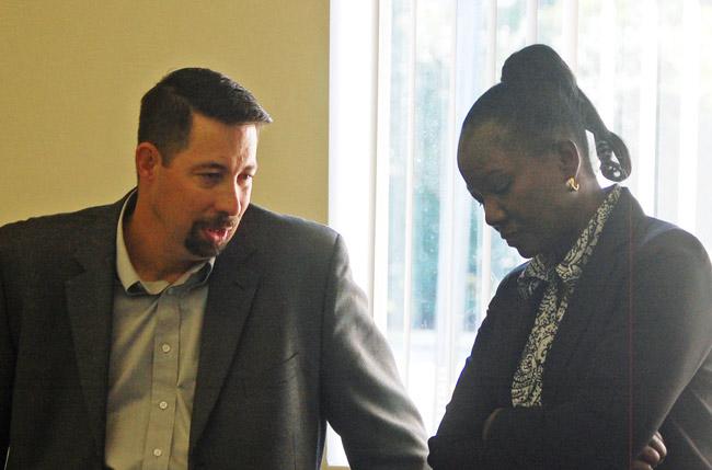 Deputy County Administrator Sally Sherman and Administrator Craig Coffey. (© FlaglerLive)