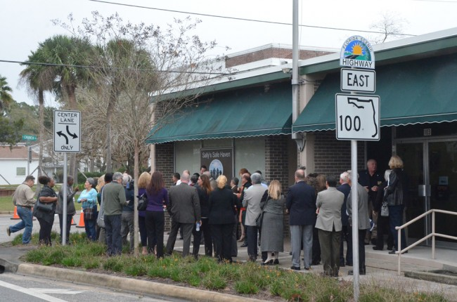 Officials from almost every local government gathered for the ribbon-cutting at the safe house, in what used to be the old Bunnell Post Office. (© FlaglerLive)