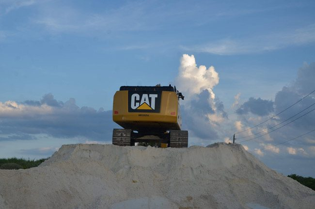 Sand brought in from Gainesville is dumped on this pile, then reloaded for dune-building. (© FlaglerLive)